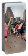 Cheerful Attractive Female Austinite Waves Her Hands With Excitement On Seeing The Austin Bats Portable Battery Charger