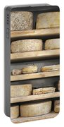 Cheese Wheels On Wooden Shelves In The Cheese Store Portable Battery Charger