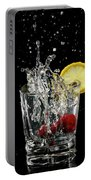 Cherries Splashing Into Sparkling Water Glass With Lemon Slice O Portable Battery Charger