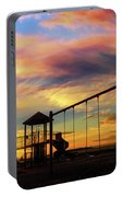 Children Playground At Sunset Portable Battery Charger