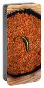 Chili In Black Pan On Wood Table With Jalapeno Pepper Portable Battery Charger