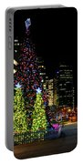 Christmas Tree On New Year's Eve In The Street Of A Big City Portable Battery Charger