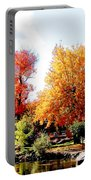 Church In The Distance In Autumn Portable Battery Charger