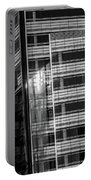 Close Up Of Black And White Glass Building Portable Battery Charger
