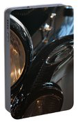 Close Up On Black Shining Car Round Light Portable Battery Charger