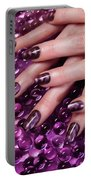 Closeup Of Woman Hands With Purple Nail Polish Portable Battery Charger