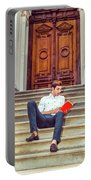 College Student Reading Red Book, Sitting On Stairs, Relaxing Ou Portable Battery Charger