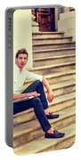 College Student Sitting On Stairs, Relaxing Outside Portable Battery Charger