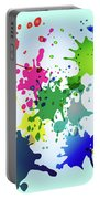Colored Splashes On A Very Beautiful Blue Background Portable Battery Charger