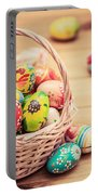Colorful Hand Painted Easter Eggs In Basket And On Wood Portable Battery Charger