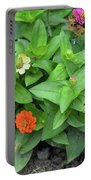 Colorful Pink And Orange Flowers In Green Leaves Bush In The Garden. Portable Battery Charger