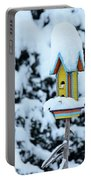 Colorful Wooden Birdhouse In The Snow Portable Battery Charger