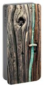 Copper Ground Wire And Knothole On Utility Pole Portable Battery Charger