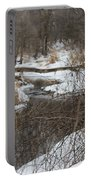 Creek Winding Through The Snow Portable Battery Charger