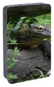 Creeping Komodo Monitor Climbing Under A Fallen Log Portable Battery Charger