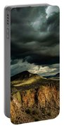 Dark Storm Clouds Over Cliffs Portable Battery Charger