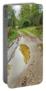 Dirty Autumn Road With Brown Pools After Rain Portable Battery Charger
