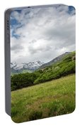 Distant Snow-capped Mountains Portable Battery Charger