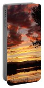 Dramatic Sunset Reflection Portable Battery Charger