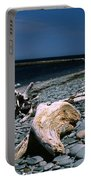 Driftwood On Rocky Beach Portable Battery Charger