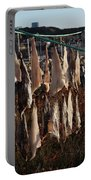 Drying Pieces Of Salt Cod In Bonavista, Nl, Canada Portable Battery Charger