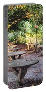 Empty Picnic Tables In The Early Fall With Fallen Leaves Portable Battery Charger