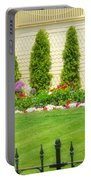 Fence Lined Garden Portable Battery Charger