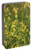 Field Of Lemon Yellow Bugle Flowers Portable Battery Charger