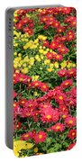 Field Of Red And Yellow Flowers Portable Battery Charger
