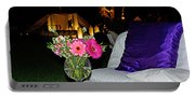 Flowers In A Vase On A White Table Portable Battery Charger