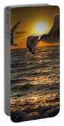 Flying Gulls At Sunset Portable Battery Charger
