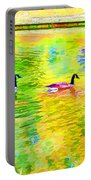 Four Canadian Geese In The Water 1 Portable Battery Charger