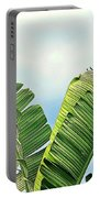 Frayed Palm Fronds Against Blue Sky Portable Battery Charger