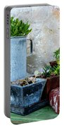 Gardening Pots And Small Shovel Against Stone Wall In Primosten, Croatia Portable Battery Charger