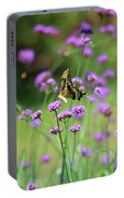 Giant Swallowtail Butterfly In Purple Field Portable Battery Charger