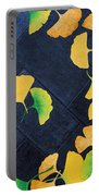 Ginkgo Leaves On Pavement Portable Battery Charger