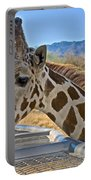 Giraffe At Feeding Station In Living Desert Zoo And Gardens In Palm Desert-california Portable Battery Charger