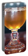 Goblet Of Refreshing Golden Beer On Shiny Dining Table Portable Battery Charger