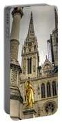Golden Angel Statues In Front Of The Cathedral Portable Battery Charger