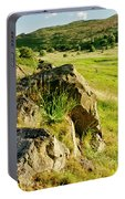Grassy Slopes And Grass On Rocks. Portable Battery Charger