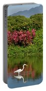 Great White Egret Fishing In A Pond With Tropical Plants And Sie Portable Battery Charger