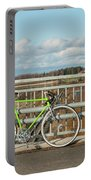 Green Bicycle On Bridge Portable Battery Charger