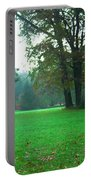 Green Dawn In Autumn Portable Battery Charger