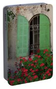 Green Windows And Red Geranium Flowers Portable Battery Charger by Yair Karelic