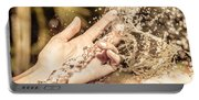 Hand Of A Woman Catching Water Stream Portable Battery Charger