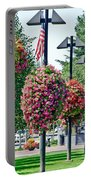 Hanging Flower Baskets In A Park Portable Battery Charger