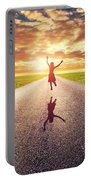 Happy Woman Jumping On Long Straight Road Portable Battery Charger