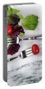 Healthy Organic Salad Flowing Out Of Plate On Natural Marble Tab Portable Battery Charger