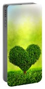 Heart Shaped Tree Growing On Green Grass Portable Battery Charger