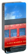 Historic Red Passenger Car, Austin & Portable Battery Charger